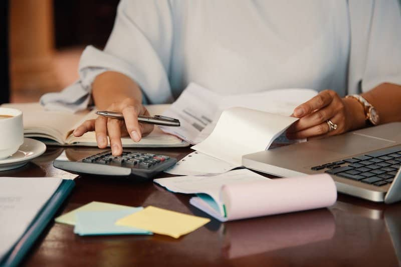 What debt should I pay off first to raise my credit score?