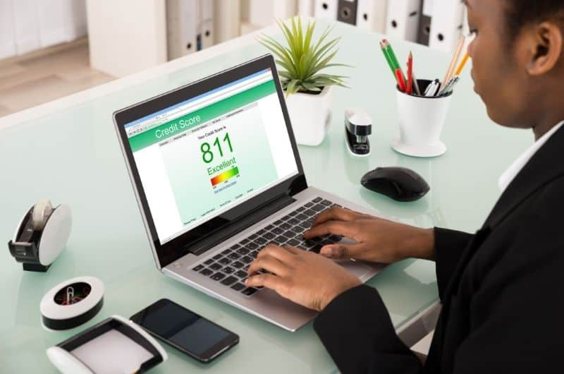 Businesswoman checking her credit score online, she currently has an 811 score.