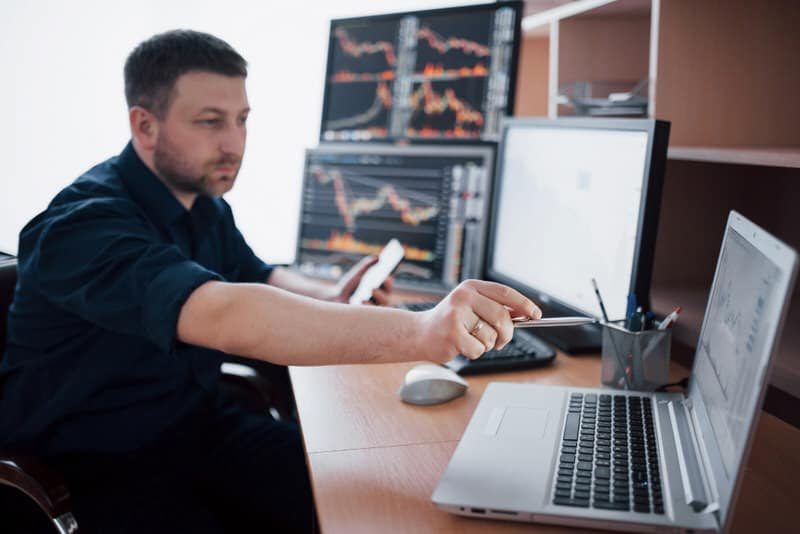 A young investor is on his computer trading on his margin account, as well as options trading.