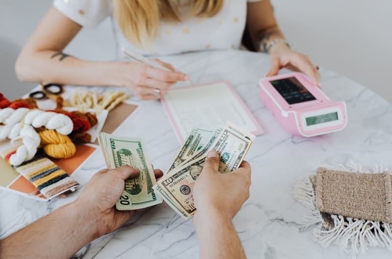 A young couple are doing their finances together to better understand how to become millionaires in the future.
