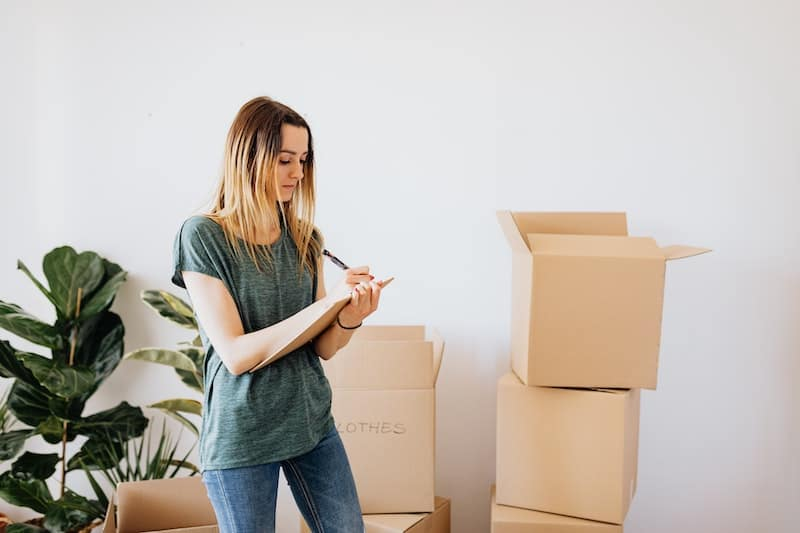 A young woman is preparing to move out of her family's house, and live on her own.