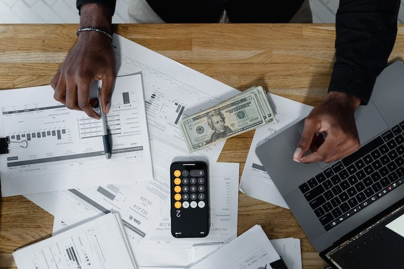 A young man is planning his budget to live alone on his average salary or $40,000/year.