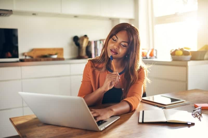 A young investor is reviewing her investing strategy to see if she should invest more of her money now, or hold and wait for a potential correction.