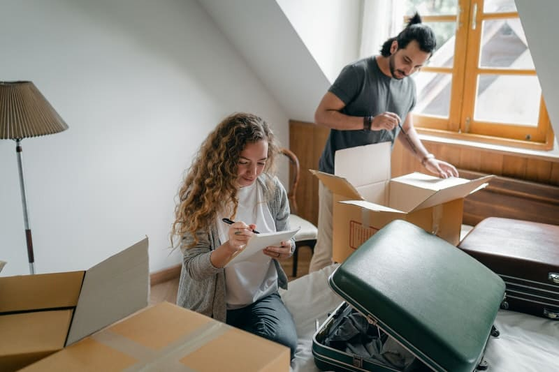 A young couple is unpacking after moving into their new home.