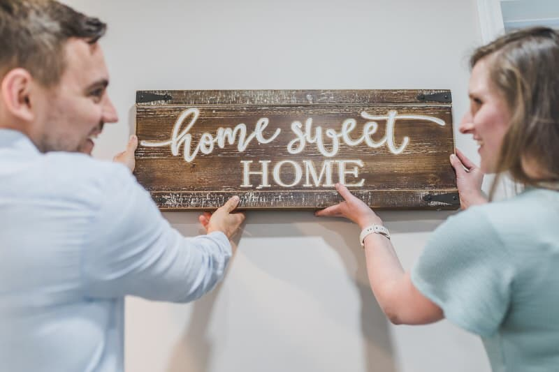 A young couple just moved into their new home, after getting help from their family for the downpayment.