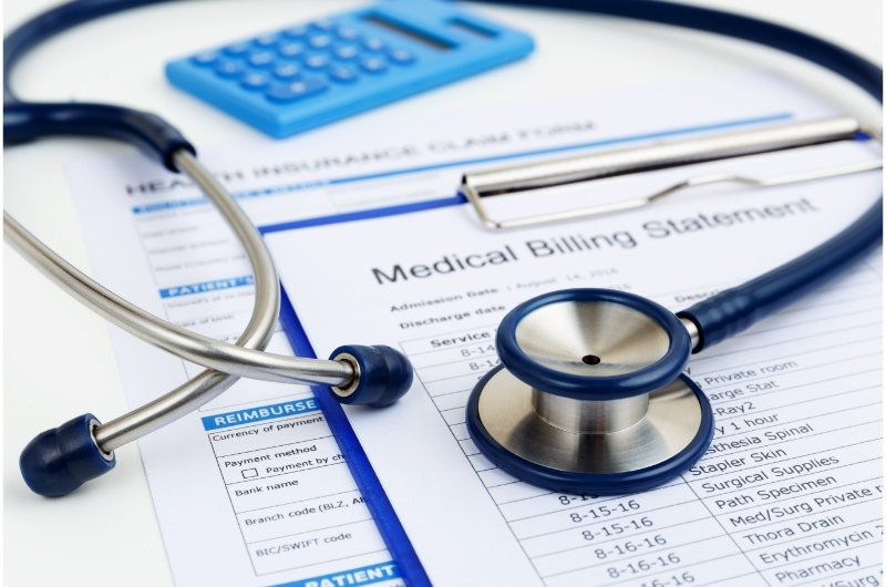 A medical bill for a patient with a stethoscope on top.