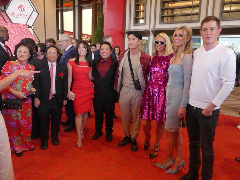 """Various """"old money"""" wealthy people at an event, Paris Hilton among one of them."""