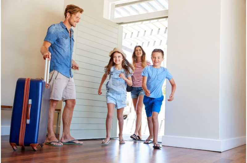 A family of 4 has just got into their rental property to stay while they're on vacation.