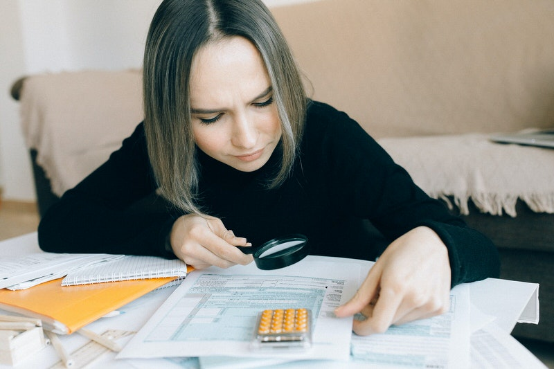 A young woman is reviewing the tax brackets to see what her total taxes would be on this years salary.