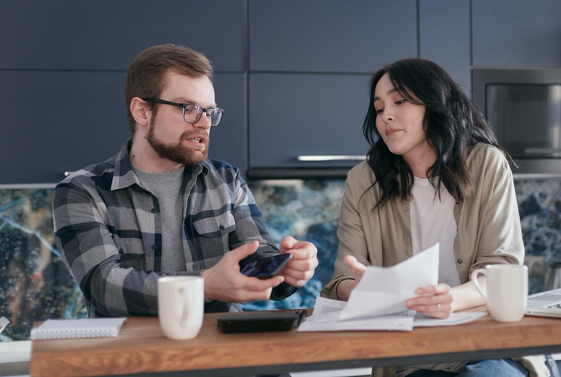 A husband is showing his wife their finances so that he can motivate her to work and become a dual-income household.
