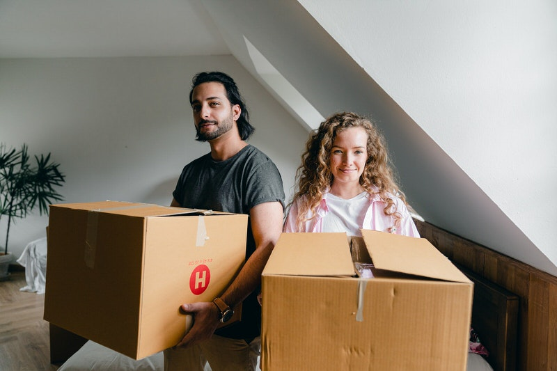 A couple is packing their belongings to move to another city for new opportunities.